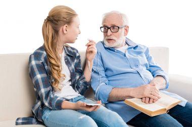 grandfather and grandchild listening music