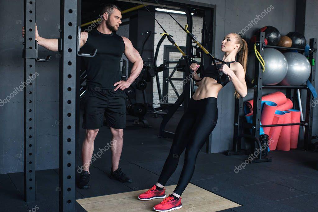 sportswoman training with trx