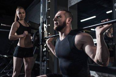 sportive man exercising at gym