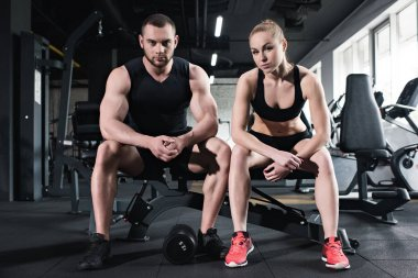 young couple of athletes training at gym