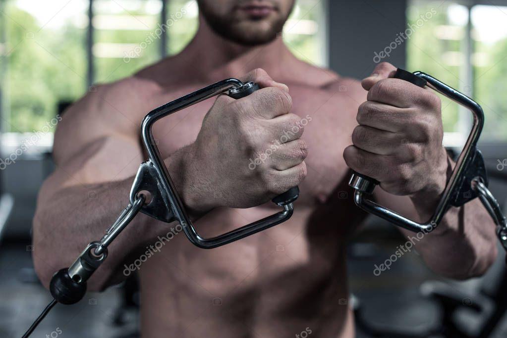 bodybuilder training with weight machine at gym