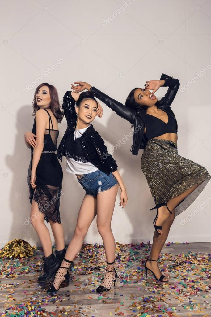 cheerful multiethnic girls dancing at party