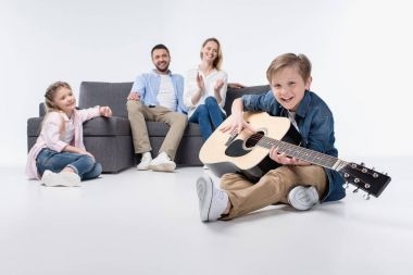 Happy family with guitar