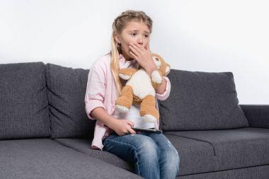 scared girl with teddy bear