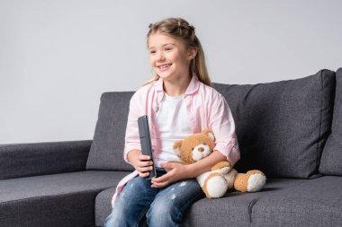 happy girl watching tv