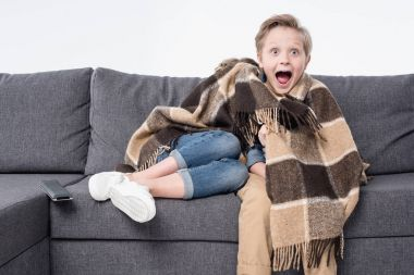 scared boy watching tv
