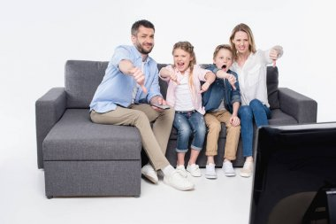 family sitting and showing thumbs down