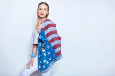 Girl in patriotic denim vest
