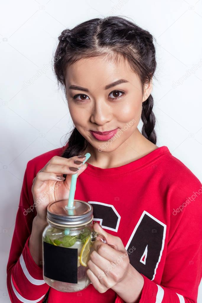 Girl drinking cold beverage