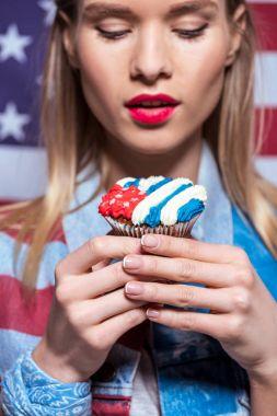 woman with sweet cupcake