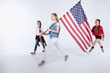 women walking with American flag