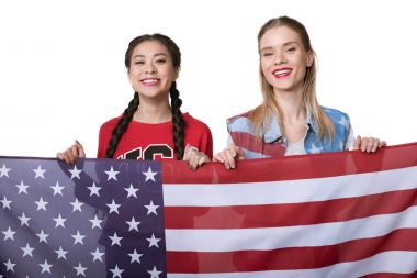 multiethnic women holding flag of USA