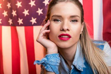 Woman posing with USA flag