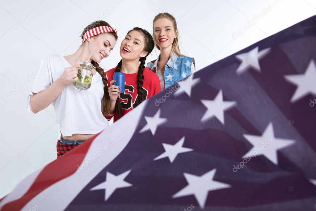 smiling girls with american flag
