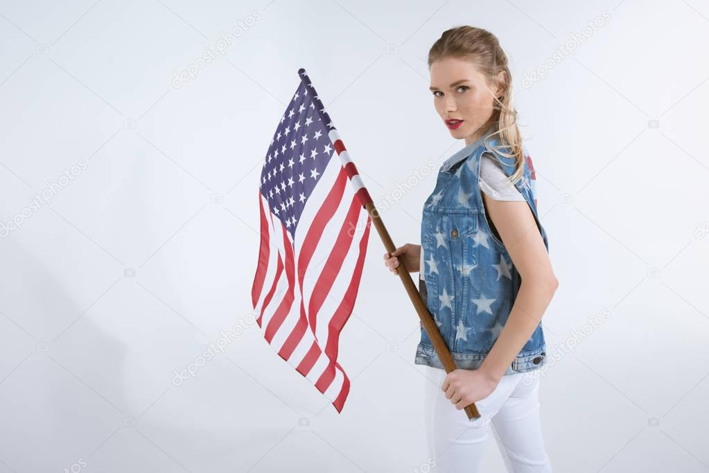 caucasian girl waving USA flag