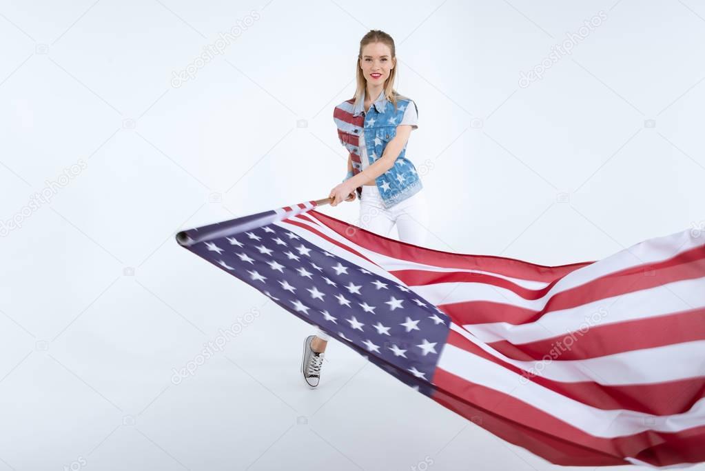 happy girl waving USA flag