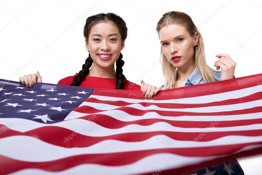 multiethnic women holding flag of USA