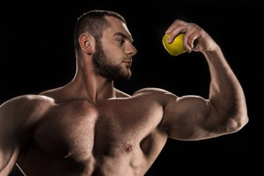shirtless athlete holding apple