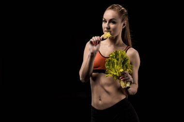 sportswoman eating Lettuce salad leaves