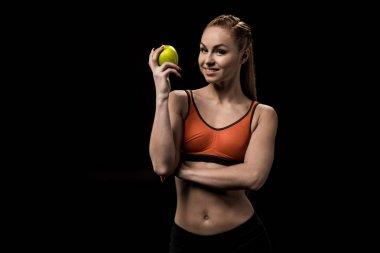 smiling caucasian sportswoman holding apple