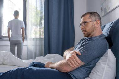 Homosexual couple in bedroom