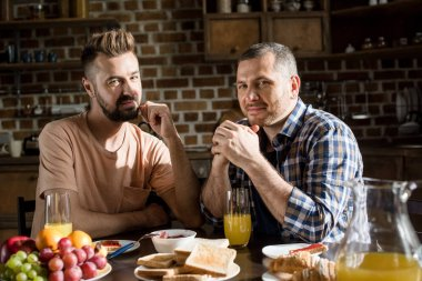 Gay couple having breakfast