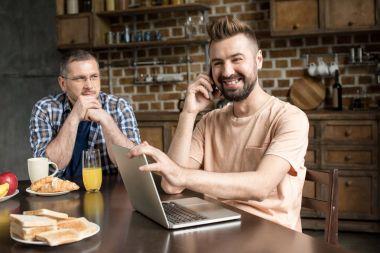Man using laptop during breakfast