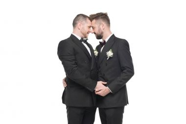 homosexual couple in suits able to kiss