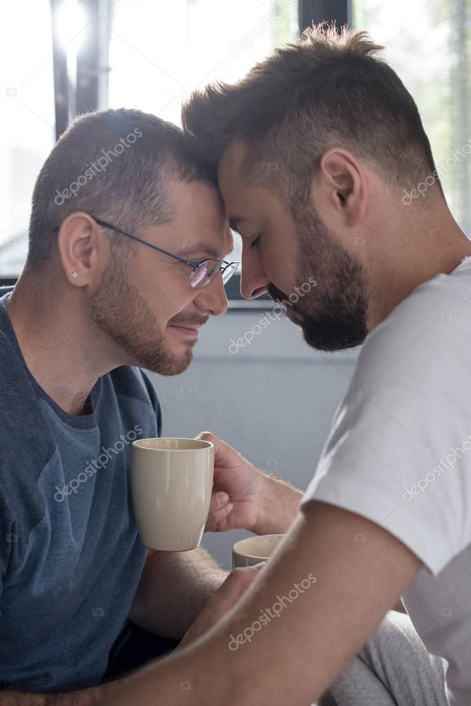 Homosexual couple drinking coffee