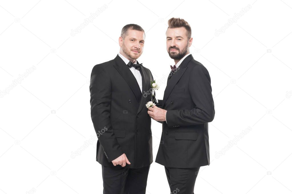 homosexual couple of grooms in suits