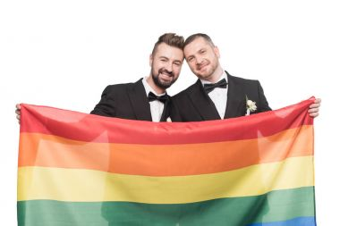 homosexual couple holding lgbt flag