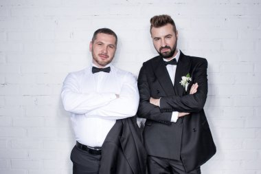 Couple of grooms posing with arms crossed