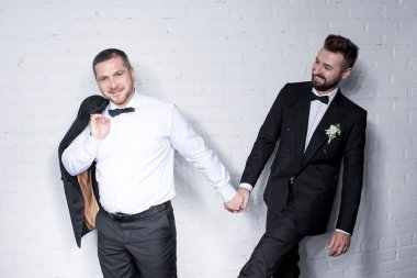 Couple of grooms holding hands