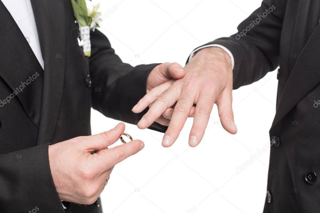 homosexual couple exchanging wedding rings