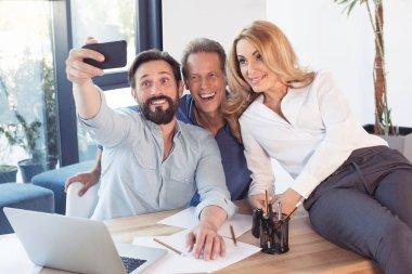 Colleagues taking selfie