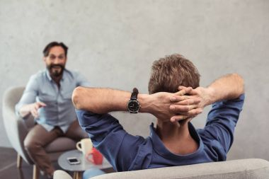 casual mature businessmen talking at break
