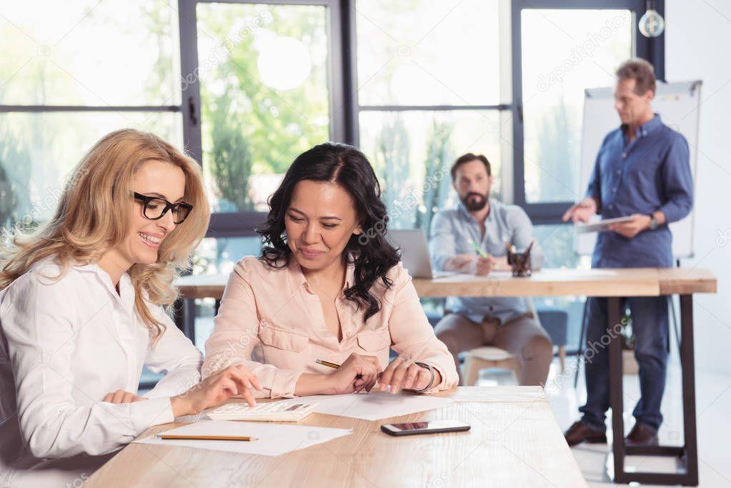 Smiling businesswomen in office