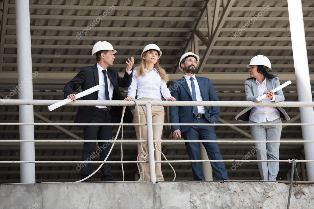 group of architects talking at construction site