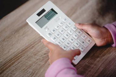 girl holding white calculator