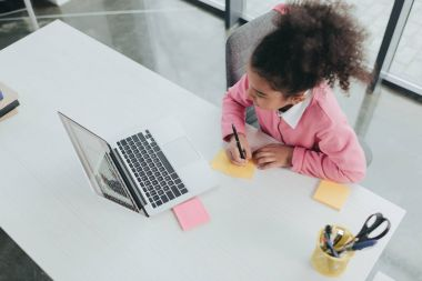 Little girl at office table