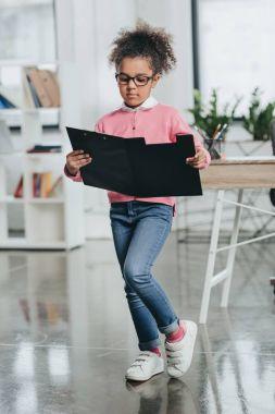 Little girl holding clipboard
