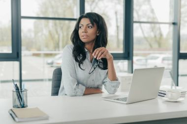 young pensive african american businesswoman