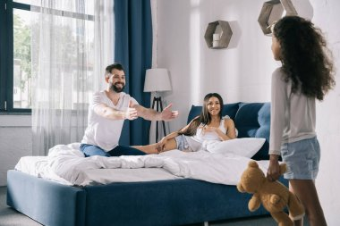 Happy family in bedroom