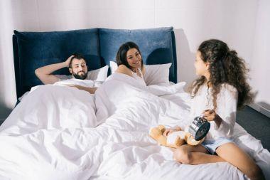 Happy family in bedroom