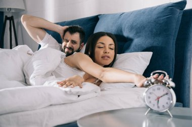 Young couple sleeping in bed
