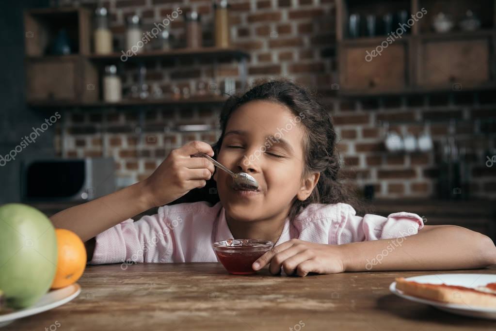 girl eating jam