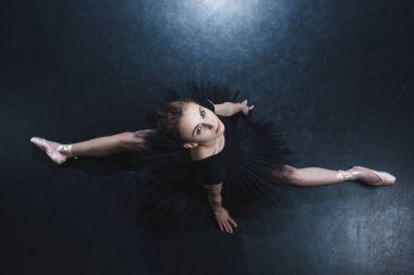 ballerina sitting on twine