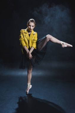 ballerina in tutu and leather jacket
