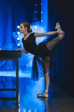 ballerina stretching in studio