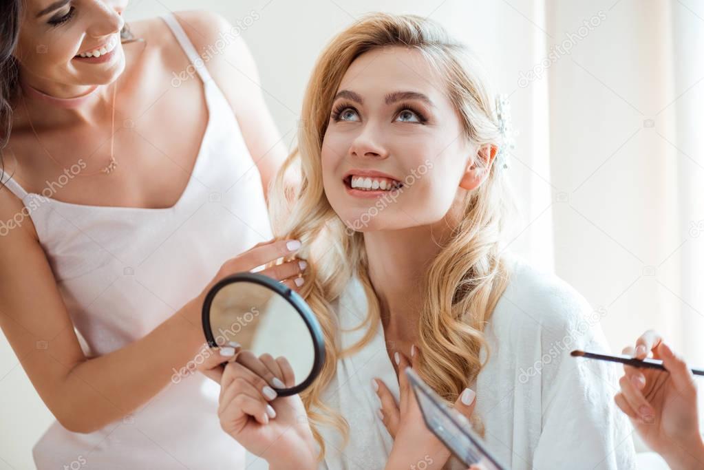 bride getting makeup before wedding